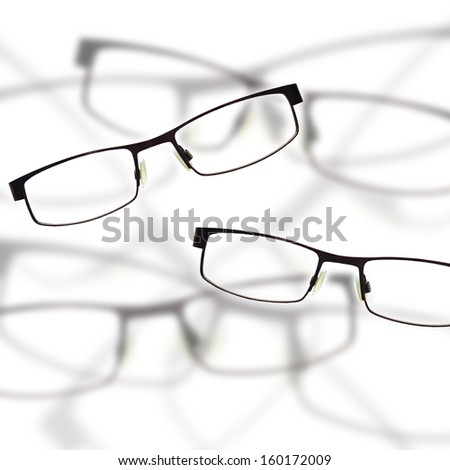 vision concepts by clear view eye glasses with out of focus background.