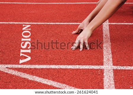 Vision - hands on starting line - stock photo
