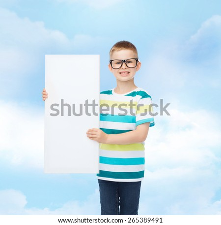 vision, health, advertisement, childhood and people concept - smiling little boy in eyeglasses with white blank board over blue cloudy sky background - stock photo