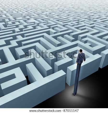 Vision in business innovative solutions solving challenges with a business man with very long legs looking above a maze and a labyrinth using strategy and planning so you do not get lost. - stock photo