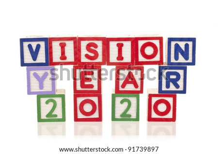 vision year 2020 word on wood blocks isolated on white background - stock photo