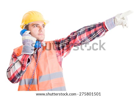 Visionary builder talking on the phone and showing up with the hand - stock photo