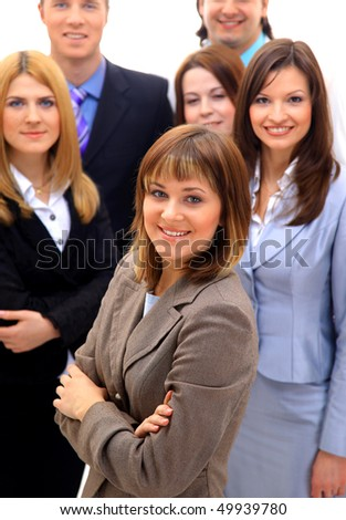 Visionary young business group - Mature business man with his colleagues in the background - stock photo