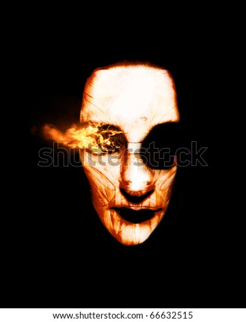 Visions Of Fire Burn From The Eye Of A Scorched Sorcerers Head In A Frightening Fiery Apparition Of Being Burnt At The Stake For Witchcraft - stock photo