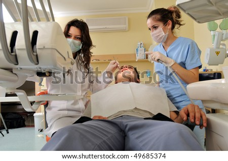 Visit at the dentist - a series of dentist related images. - stock photo