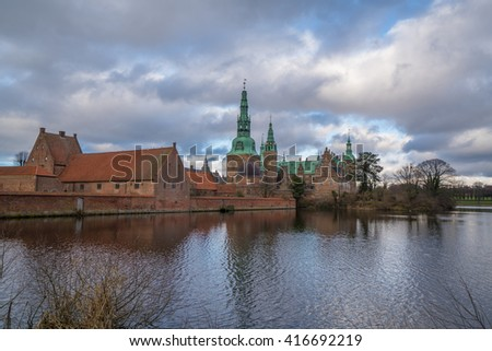 visit frederiksborg castle in copenhagen denmark very nice old castle it have reflection river  - stock photo