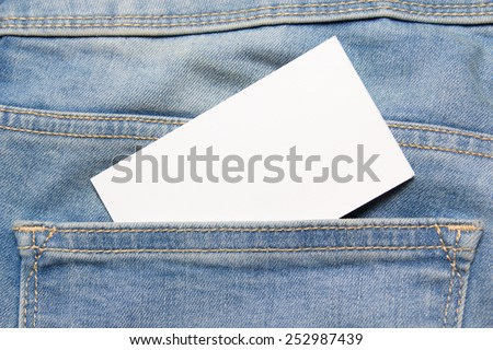 visiting card in back pocket of old blue jeans - stock photo