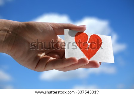 Visiting card with symbol of broken heart - stock photo