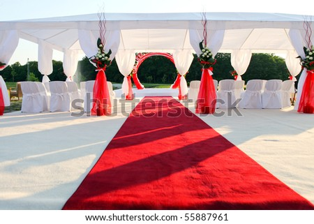 visiting ceremony with white decoration and red carpet - stock photo