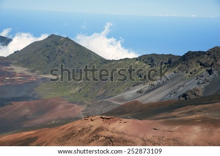 Visitors can hike along trails inside ancient Haleakala crater in Maui Hawaii.  - stock photo