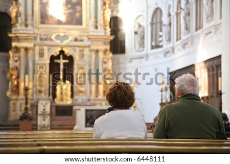 visitors in cathedral - stock photo