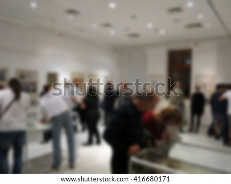 Visitors to the museum, blurred 100% - stock photo