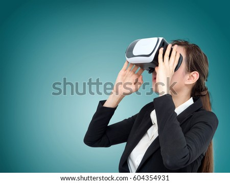 Visual reality concept.Young business Asian woman using Visual reality or VR headset.Woman getting experience using VR-headset glasses.