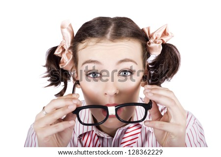Visually Impaired Woman Squinting Over A Pair Of Nerdy Glass To Try To Read In A Funny Optometry Concept On White Background - stock photo