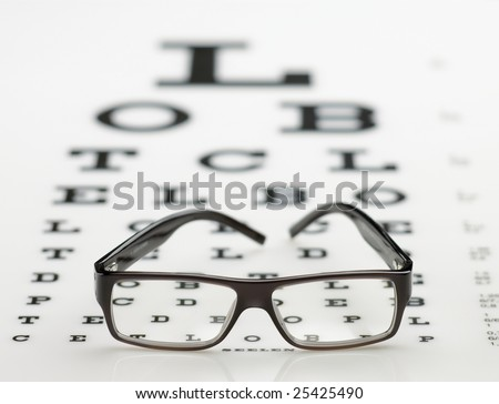Visus chart with eyeglasses - stock photo
