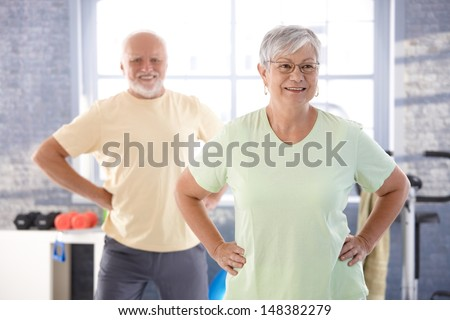 Vital pensioners exercising in the gym. - stock photo