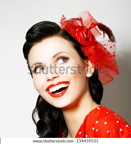Vitality. Cheerful Young Woman with Red Bow enjoying. Pleasure - stock photo