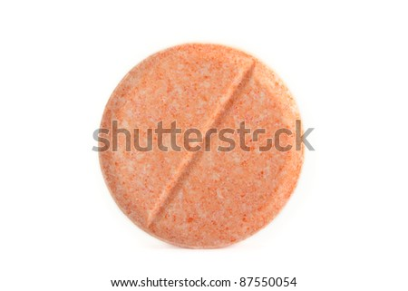 Vitamin C tablet, isolated on a white background. - stock photo