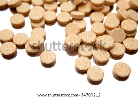 Vitamin C tablets on white background