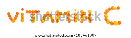 Vitamin C written on white background with citrus fruits. Oranges, grapefruits and lemons making a vitamin text.