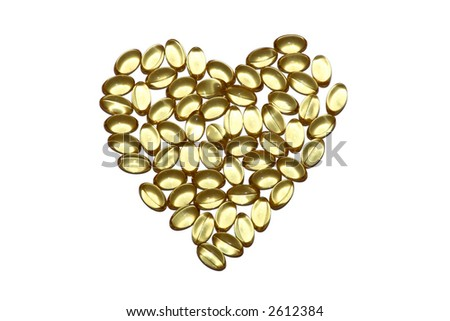 Vitamin capsules arranged in the shape of a heart to portray the concept of a healthy heart and lifestyle