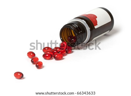 Vitamin E capsules with bottle on a white background