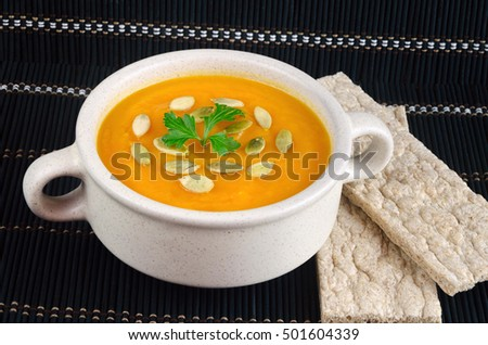 vitamin fresh pumpkin puree soup with white seeds, health food
