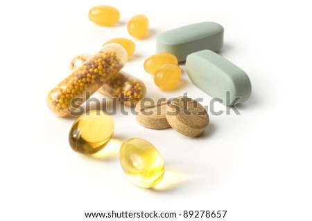 Vitamin herbal medicine pills/ tablets / capsules isolated on white background  with shadows
