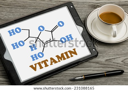 vitamin  molecular map on touch screen background - stock photo