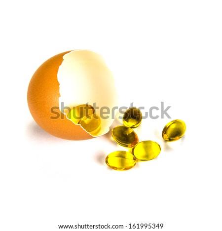 Vitamin Omega-3 fish oil capsules with eggshell. - stock photo