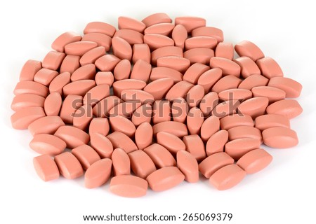 vitamin pills on white background - stock photo