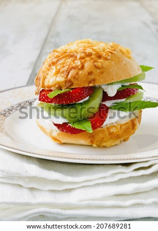 vitamin sandwich of cottage cheese and various fruits on a plate. health and diet concept - stock photo