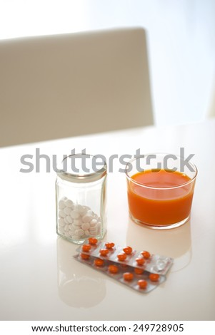 Vitamin tablets and vegetable juice