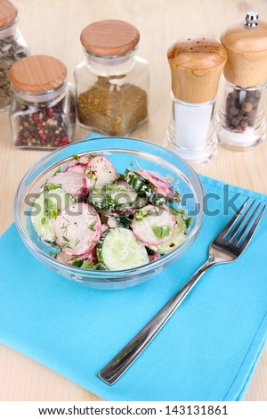Vitamin vegetable salad in bowl on wooden table close-up
