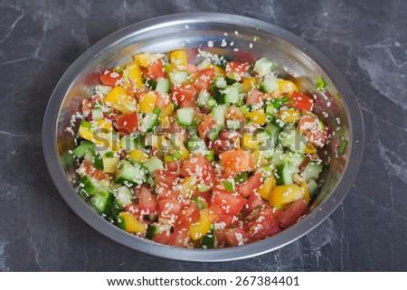 Vitamin vegetable salad slices with sesame seeds  - stock photo