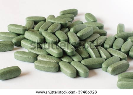 Vitamine tablets, used a dietary supplement - stock photo