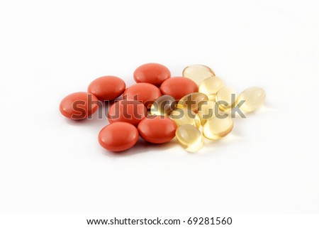 Vitamins and medications on a white background