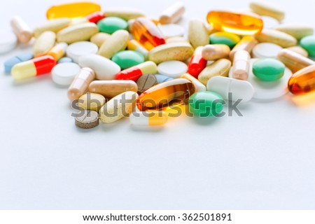 Vitamins, omega 3, cod-liver oil, dietary supplement and tablets an embankment on a light background close up, the top view - stock photo