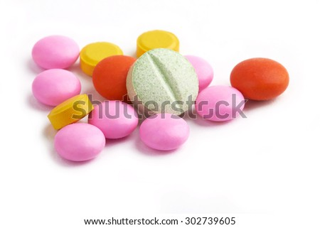 vitamins, pills and tablets on white background