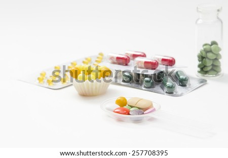 vitamins, pills, capsules in blisters and on white background - stock photo