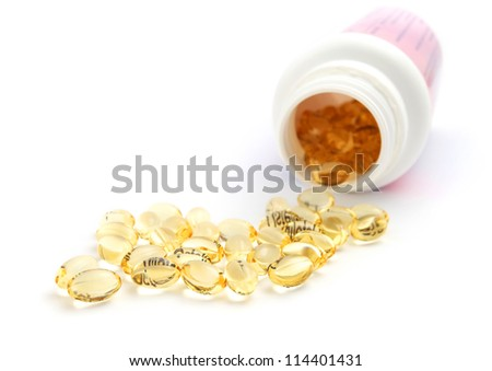 Vitamnin D Capsule with bottle isolated on white - stock photo