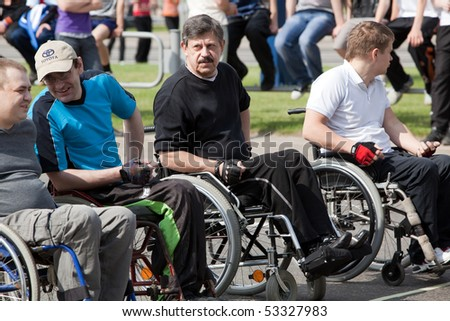 "VITEBSK, BELARUS - MAY 15: Start of sportsmen-invalids on a sports holiday ""The international Olympic day"" May, 15, 2010 in Vitebsk, Belarus - stock photo"