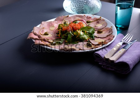 vitello tonnato on a serving plate with water - stock photo