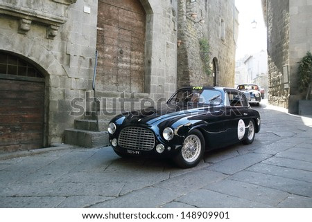 VITERBO ITALY - MAY 18: Green (BRG) Dark blue Ferrari 166 Touring coupe, built in 1950, takes part to the 1000 Miglia historic car race, on May 18, 2013 in Viterbo - stock photo