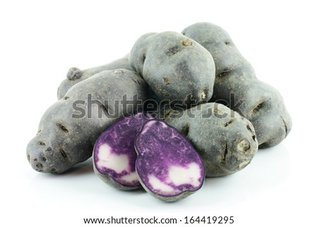 Vitolette noir or purple potato. On a white background - stock photo