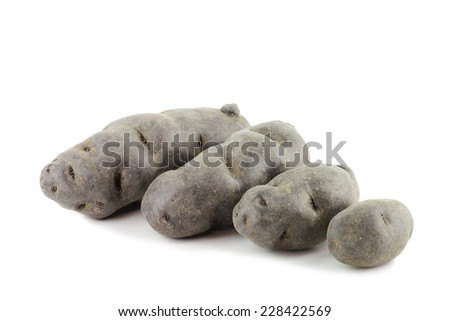 Vitolette noir or purple potato. (truffe de chine) On a white background - stock photo