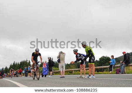 VITORIA-GASTEIZ, SPAIN - JULY 29 : Athletes competing in the cycling section of the Long Distance Triathlon World Championships, July 29, 2012 in Vitoria Gasteiz, Basque Country, Spain