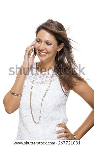 Vivacious attractive woman reacting to a text message on her mobile phone flicking her hair in the air and staring at the phone with her mouth open, on white with copyspace - stock photo