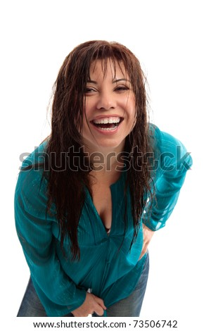 Vivacious fun loving exuberant brunette woman leaning forward and laughing hysterically mouth open, - stock photo
