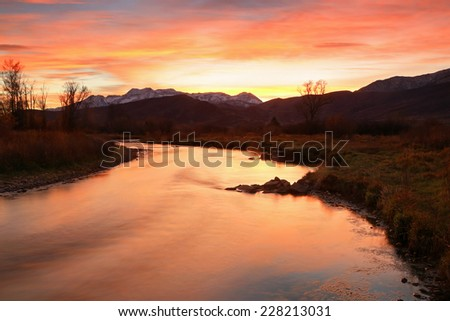 Vivid autumn sunset above the Provo River, Heber Valley, Utah, USA. - stock photo
